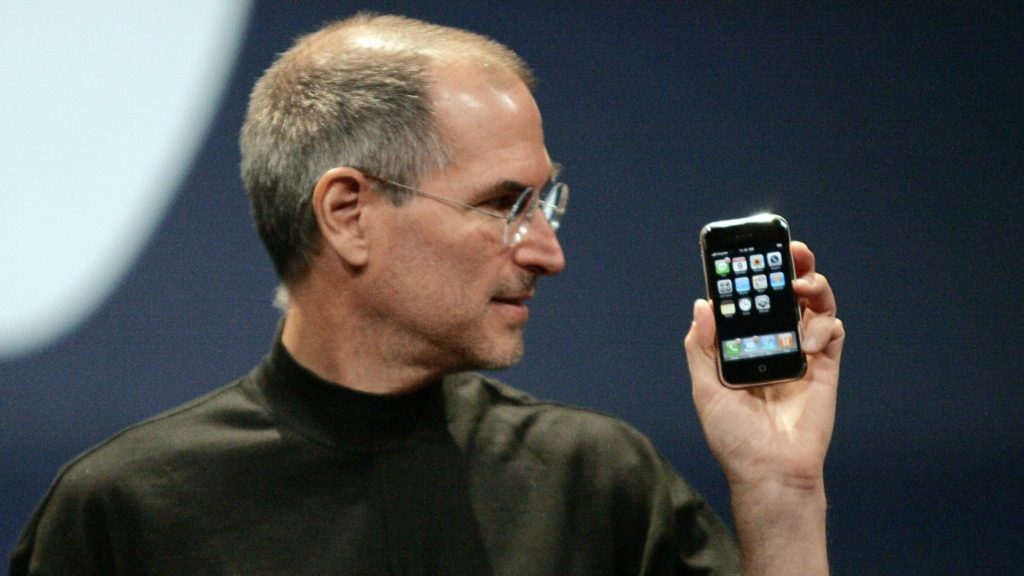 Apple Chief Executive Officer Steve Jobs holds new iPhone in San
