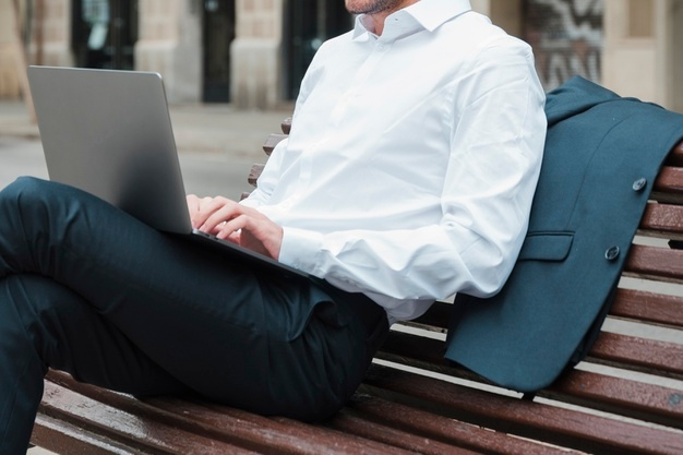 relaxed businessman sitting bench using laptop 23 2148176109